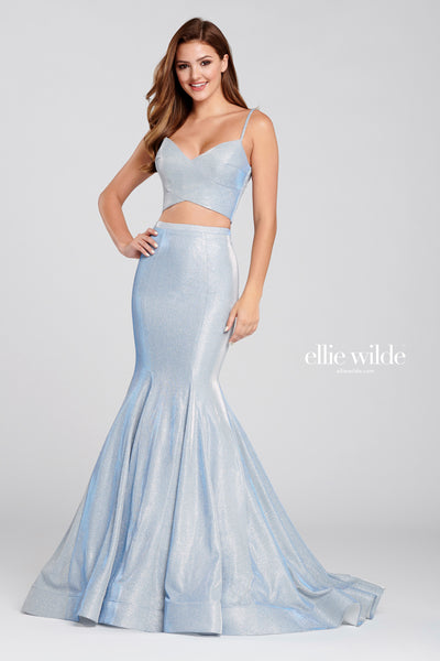 Sleeveless novelty stretch glitter two-piece trumpet gown with a v-neck, natural waist, lace up back, horsehair hem and a sweep train. Prom 2020