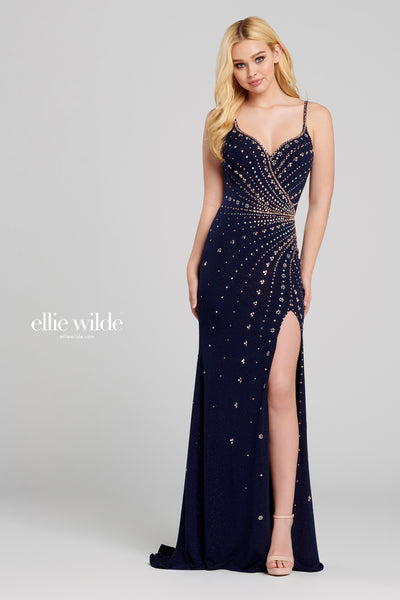 Sleeveless glitter jersey slim fit gown with a v-neck, natural waist, strappy criss cross back, thigh slit, stone accents throughout gown and a sweep train.  Prom 2020