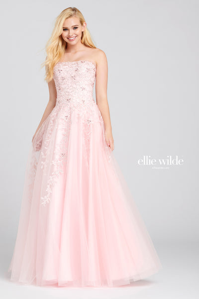 Strapless embroidered tulle a-line gown with a straight neckline, stone accents throughout the gown, high back and a flowy skirt.  Prom 2020