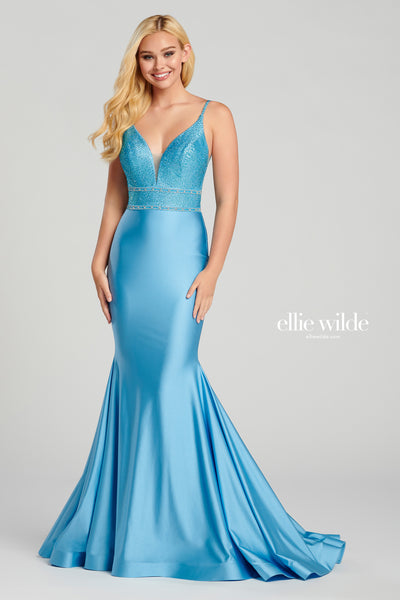 Sleeveless novelty stretch fit and flare gown with a plunging v-neck, sheer insets on the sides, stone accents throughout bodice, plunging open back with a ruched detail, horsehair hem and a sweep train.  Matching Accessories EW1201T, EW1201B, EW1201C Prom 2020