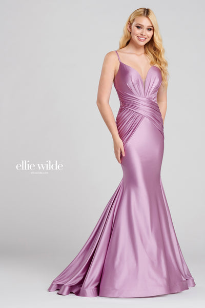 Sleeveless novelty stretch fit and flare gown with a plunging v-neck, draping around the natural waist, horsehair hem and a sweep train. Matching Accessories EW1201T, EW1201B, EW1201C Prom 2020
