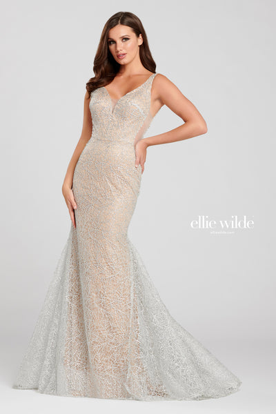 Sleeveless cracked ice and venise lace trumpet gown with a plunging v-neck, sheer side insets, natural waist, scoop back, horsehair hem and a sweep train.  Prom 2020