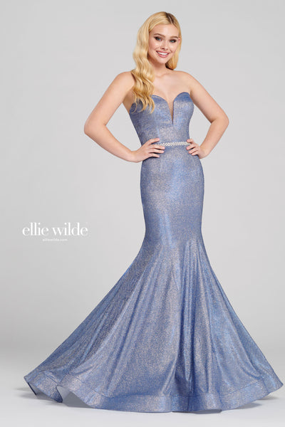 Strapless novelty stretch glitter trumpet gown with a plunging sweetheart gown, rhinestone detail at the natural waist, horsehair hem and a sweep train.  Prom 2020