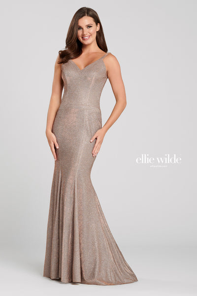 Sleeveless novelty stretch glitter fit and flare gown with a v-neck, drop waist, criss cross back, and a sweep train.  Prom 2020