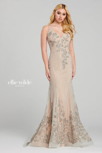 Sleeveless beaded and embroidered tulle fit and flare gown with a v-neck, low back, stone accents throughout, horsehair hem and a sweep train.  Prom 2020