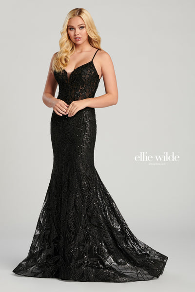 Sleeveless embroidery and cracked ice slim fit gown with a plunging v-neck, sheer bodice, natural waist, criss cross back, horsehair hem and a sweep train.  Prom 2020