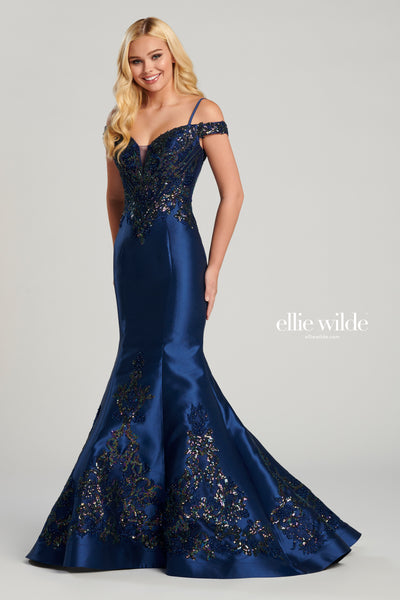 Off-the-shoulder sequin embroidery and mikado mermaid gown with a plunging sweetheart neckline, spaghetti strap detail, sequin embroidery on the bodice and down the back of the gown, natural waist, lace up back, horsehair hem and a sweep train.  Prom 2020