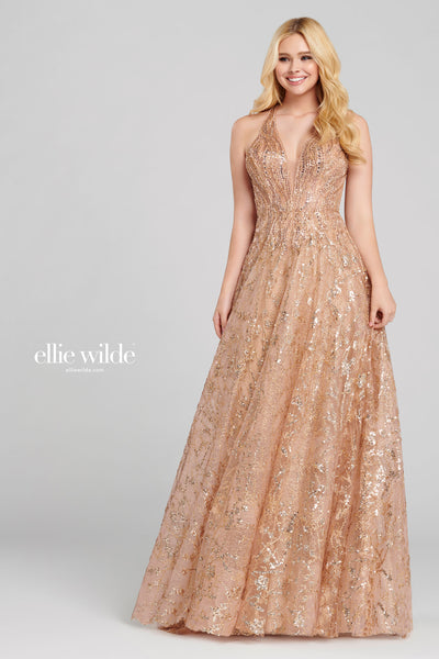 Sleeveless cracked ice a-line gown with a plunging v-neck, natural waist, strappy back, flowy skirt and a small train. Features pockets.  Prom 2020