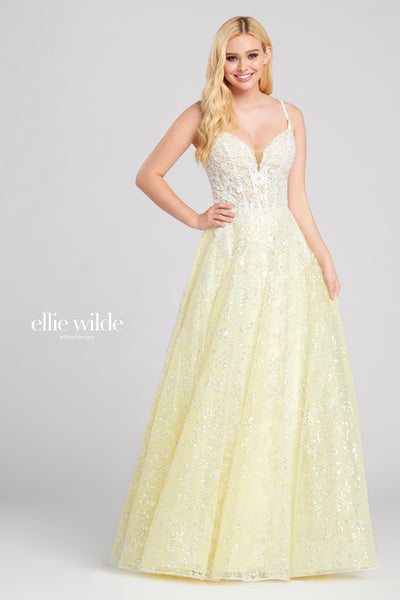 Sleeveless sequin lace and lace applique a-line gown with a v-neck, sheer corset bodice, natural waist, strappy back and a flowy skirt.  Prom 2020