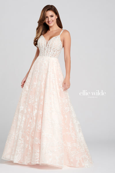 Sleeveless embroidered tulle a-line gown with a plunging v-neck, double spaghetti strap, natural waist, strappy back and a flowy skirt. Feature pockets.  Prom 2020