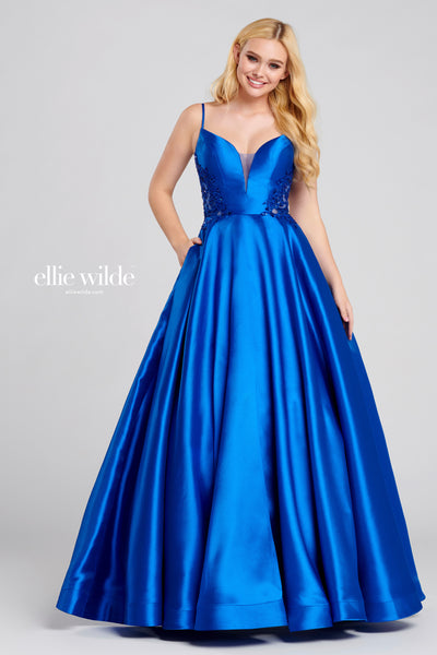 Sleeveless mikado ball gown with a plunging v-neck, sheer side cut outs with sequin embroidery on the sides and back, scoop back, natural waist, full skirt, horsehair hem and a sweep train. Features pockets Prom 2020