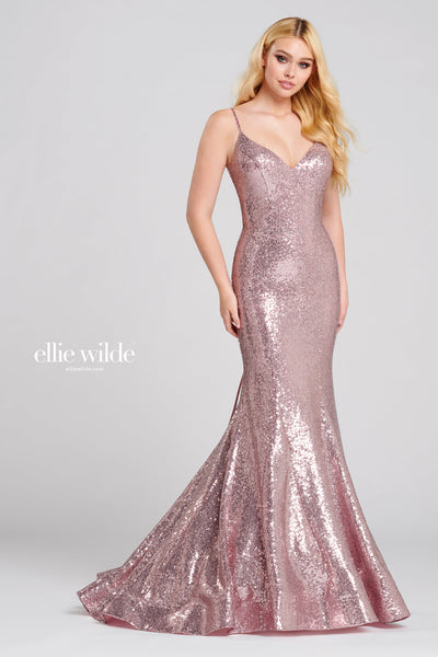 Sleeveless sequin fabric fit and flare gown with a v-neck, natural waist, lace up cut out back, horsehair hem and a sweep train.  Prom 2020