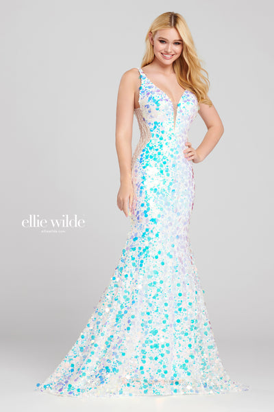 Sleeveless novelty sequin fit and flare gown with a plunging v-neck, sheer beaded insets on the sides,v-back and a sweep train.  Prom 2020