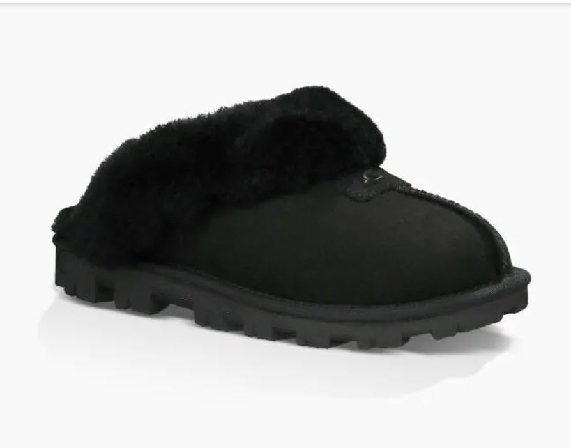 Ugg Coquette - The Classic Ugg Slipper in Black. Nothing feels cozier than this Ugg classic slipper mule. Perfect for when you are working from home or walking the dog. Suede sheepskin upper & sock lining, lighweight full rubber sole.