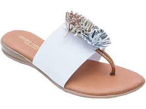 Novalee The Elastic Thong Sandal in White Slide on and go. The elastic single band with festive puff decor adds a pop of fun to any ensemble. Feel delicious all day in memory foam cushioned insoles. Walking. Lunching. Boardwalk, brunch, dinner. Easy Breezy and So Cute. Andre Assous