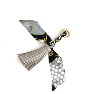 The Tassel Scarf Charm in Charcoal