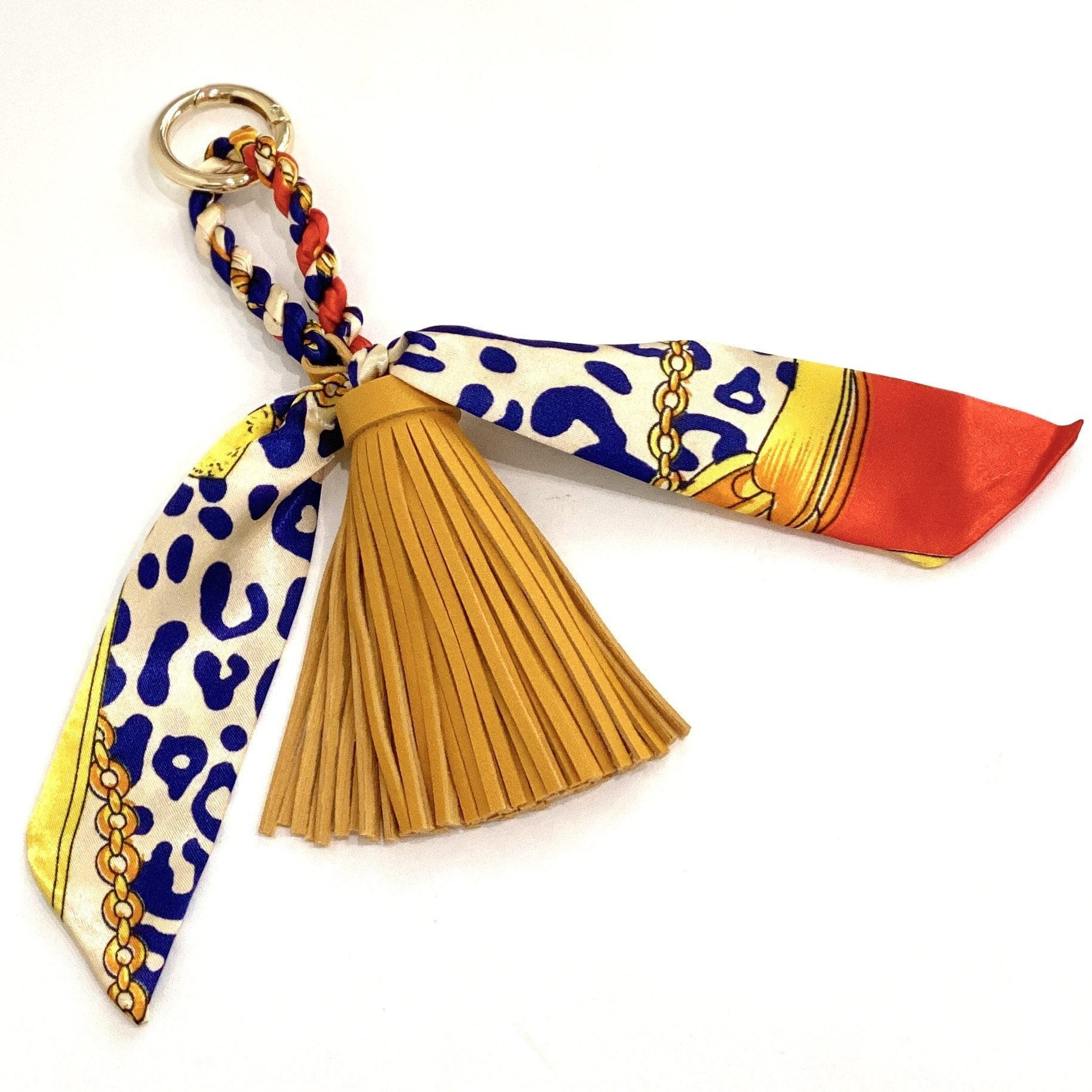 The Tassle Scarf Charm in Mustard