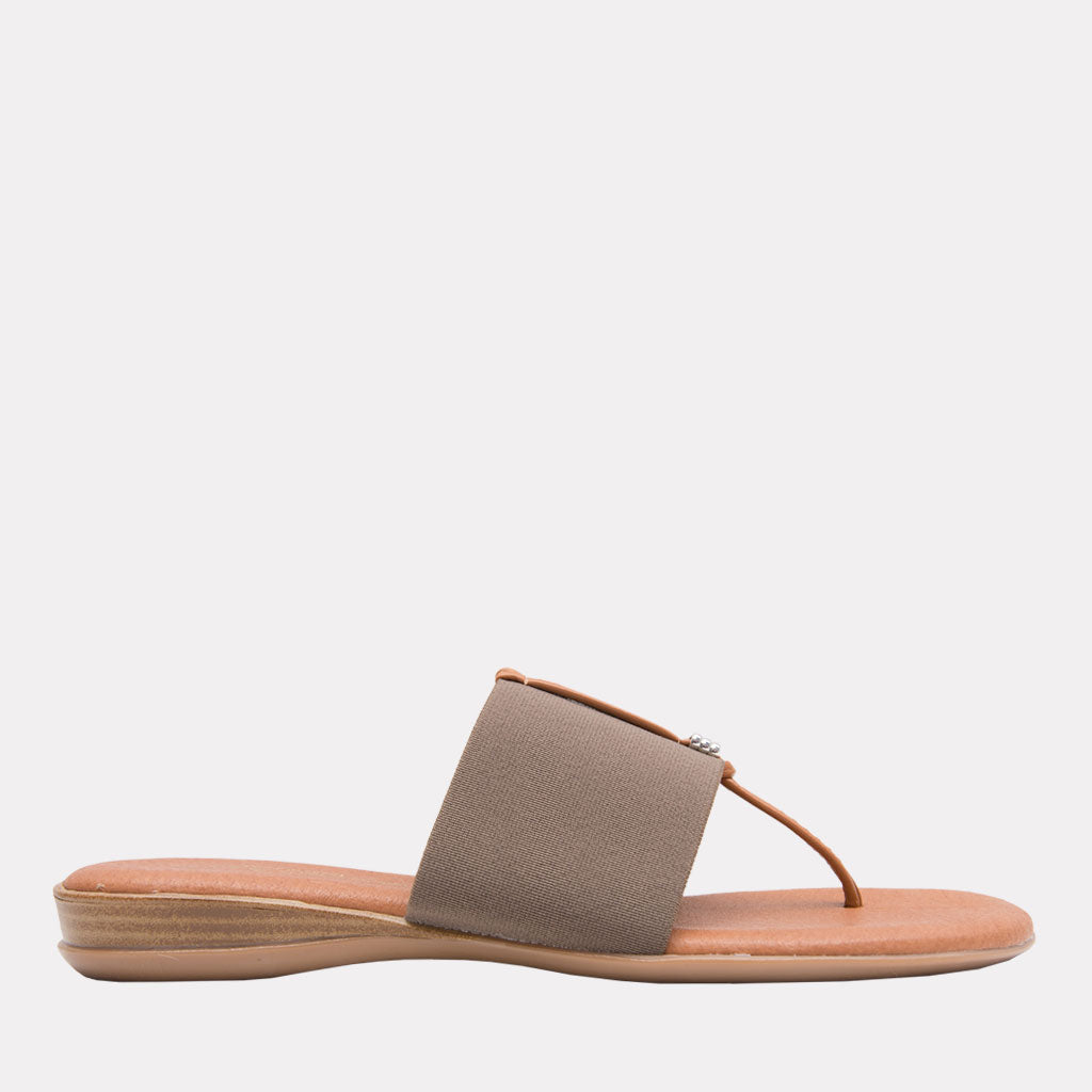 Nice - The Slide Sandal in Taupe Andre Assous Slide on and go. The single band style works with any outfit. Memory foam insoles make these as comfortable as they are easy. Walking. Lunching. Boardwalk, brunch, dinner. The lovely taupe neutral works with so much. Easy Breezy.