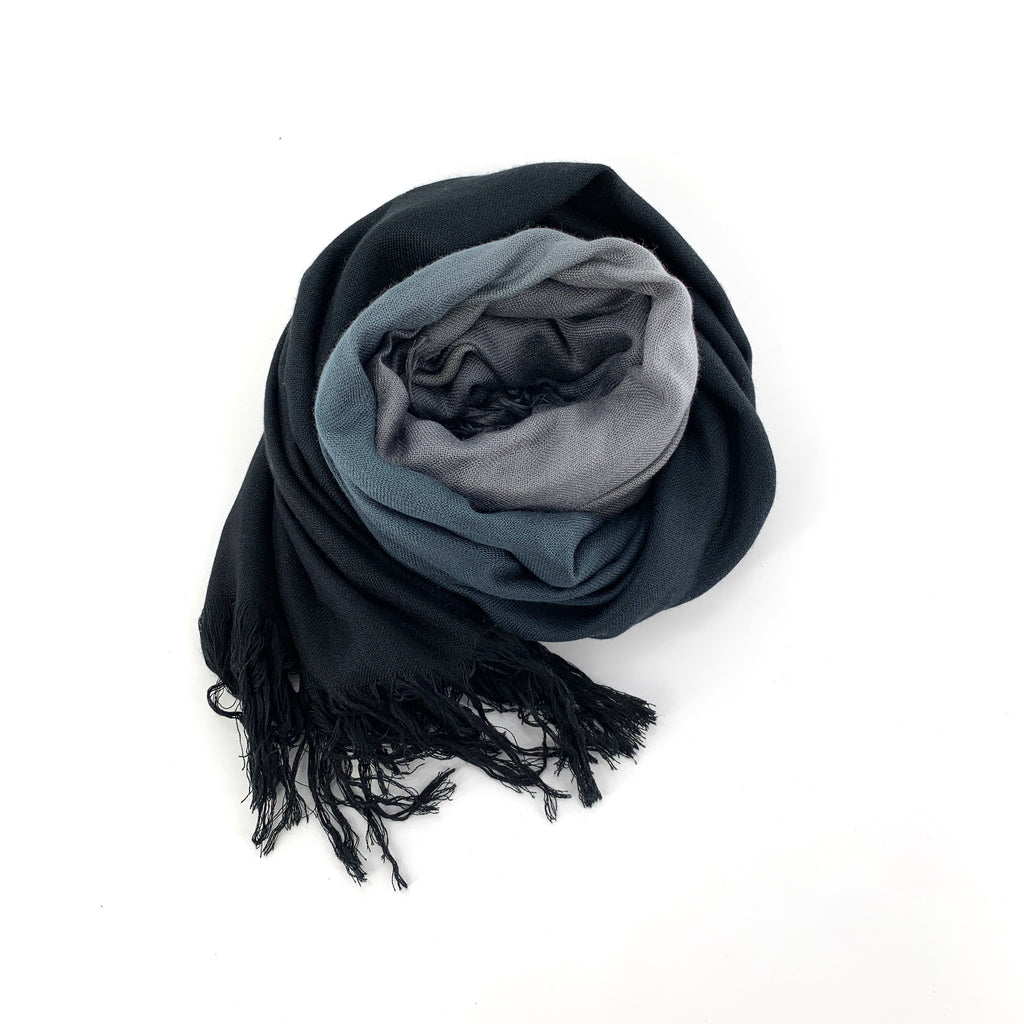 "TSD101- Tissue Scarf in Ombre Silver Black by Blue Pacific. Super silky and lightweight makes this fringed scarf the perfect, hand dyed, layering piece. Oversized at 60"" x 60"" it can also be used as a wrap. Made in Spain."
