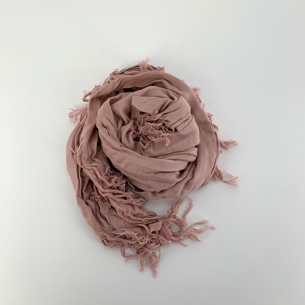 "TSD113 - Solid Tissue Scarf in Misty Rose by Blue Pacific. Super silky and lightweight makes this fringed scarf the perfect, hand dyed, layering piece. Oversized at 60"" x 60"" it can also be used as a wrap. Made in Spain."
