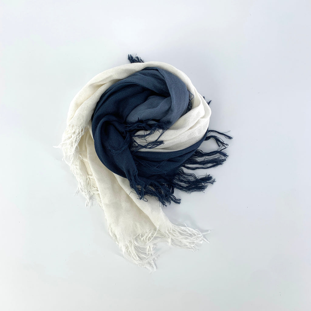 "TSD9636 - Solid Tissue Scarf in Blueberry by Blue Pacific. Super silky and lightweight makes this fringed scarf the perfect, hand dyed, layering piece. Oversized at 60"" x 60"" it can also be used as a wrap. Made in Spain."