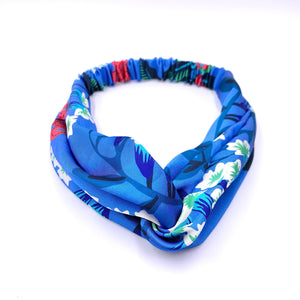Echo EN0888 - Soft Twist Headband in Blue Floral by Echo. Fun patterns with a twist. These headbands can turn any bad hair day into a good one.