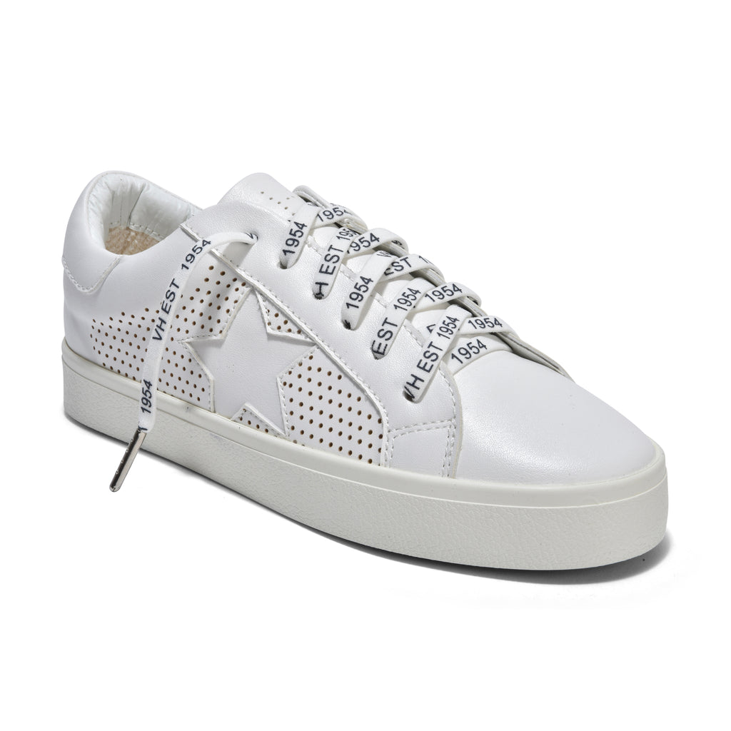 Vintage Havana The Star Perforated Lace Sneaker in White. This best selling perforated all white star lace sneaker is sylish, chic & versatile. Synthetic & leather upper, rubber sole, terry cloth lining & elastic laces for easy slip-on styling.