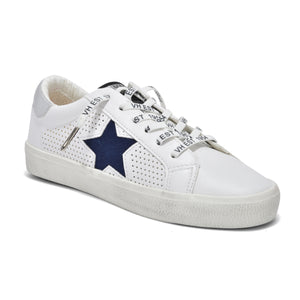 Gadol The Star Perforated Lace Sneaker in White Navy Vintage  Havana. This best selling perforated white lace sneaker with navy star is sylish, chic & versatile. Synthetic & leather upper, rubber sole, terry cloth lining & elastic laces for easy slip-on styling.