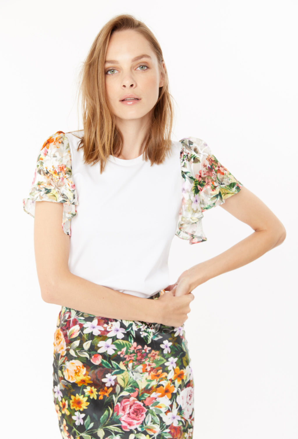 Kati - The Floral sleeve Top in White by Generation Love. Update your white tee shirt with this fun and flirty sheer floral print sleeve tee. Best seller!