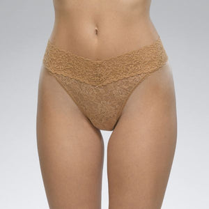 "Hanky Panky 4811P - Original Rise Thong in Suntan by Hanky Panky. Original Rise fits higher on the hips. Has a signature V-front and V-back waistband, and leaves no visible panty line. One-size fits most (hips measuring 36""- 45""). Made in the USA."