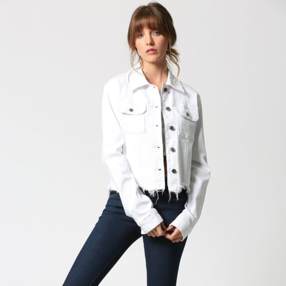 HD869J - The Rebel Frayed Hem Denim Jacket in White by Hidden. This fitted, cropped, frayed hem jacket has an uneven hem and 2 side pockets. Our favorite denim jacket and best seller has the perfect fit and length to throw on over dresses, skirts or jeans!