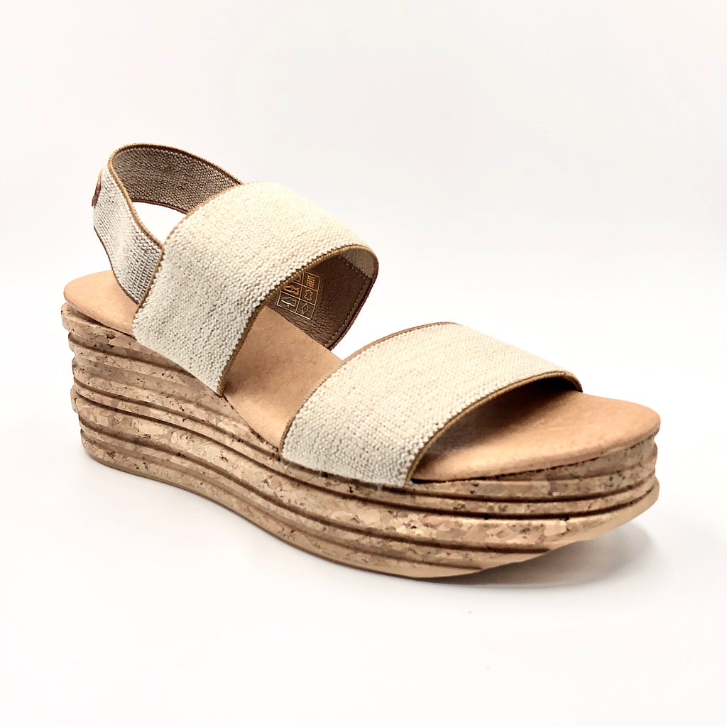 This easy elastic sandal on cork designer wedge gives you added height without the discomfort. The flatform cork wedge with padded sock lining, keeps your foot at a comfortable angle. Elastic upper, cork wedge & full rubber sole. Whole European size only. If you are a half size, larger whole size recommended.