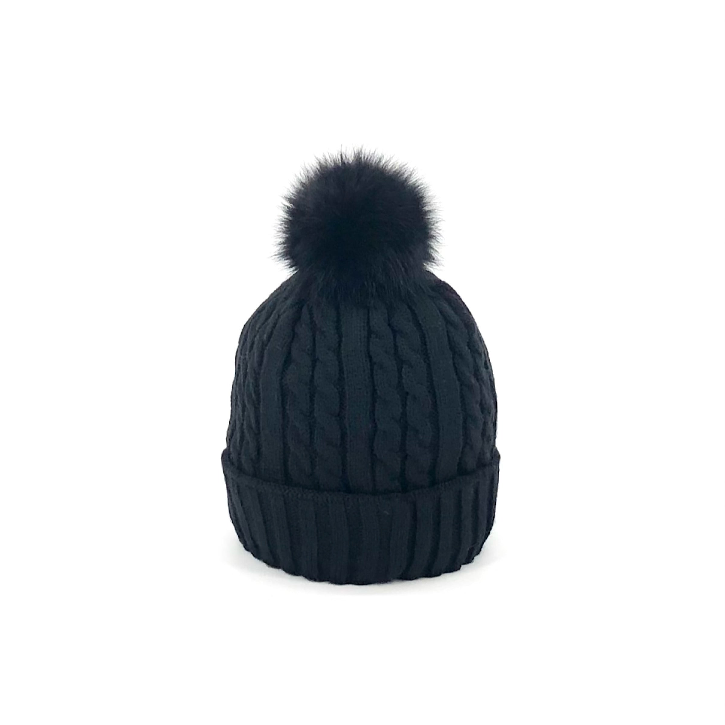 The Cable Knit Beanie in Black with Fleece Lining & Black Fox Pom