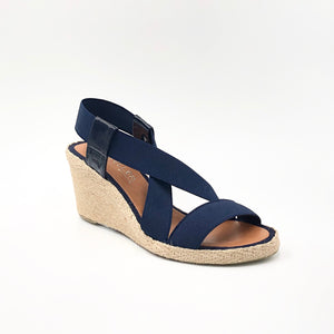 The Elastic Espadrille Sandal in Navy Go anywhere in this classic top selling elastic espadrille on mid wedge. The elastic upper fits & flatters all types of feet and offers a great deal of comfort.