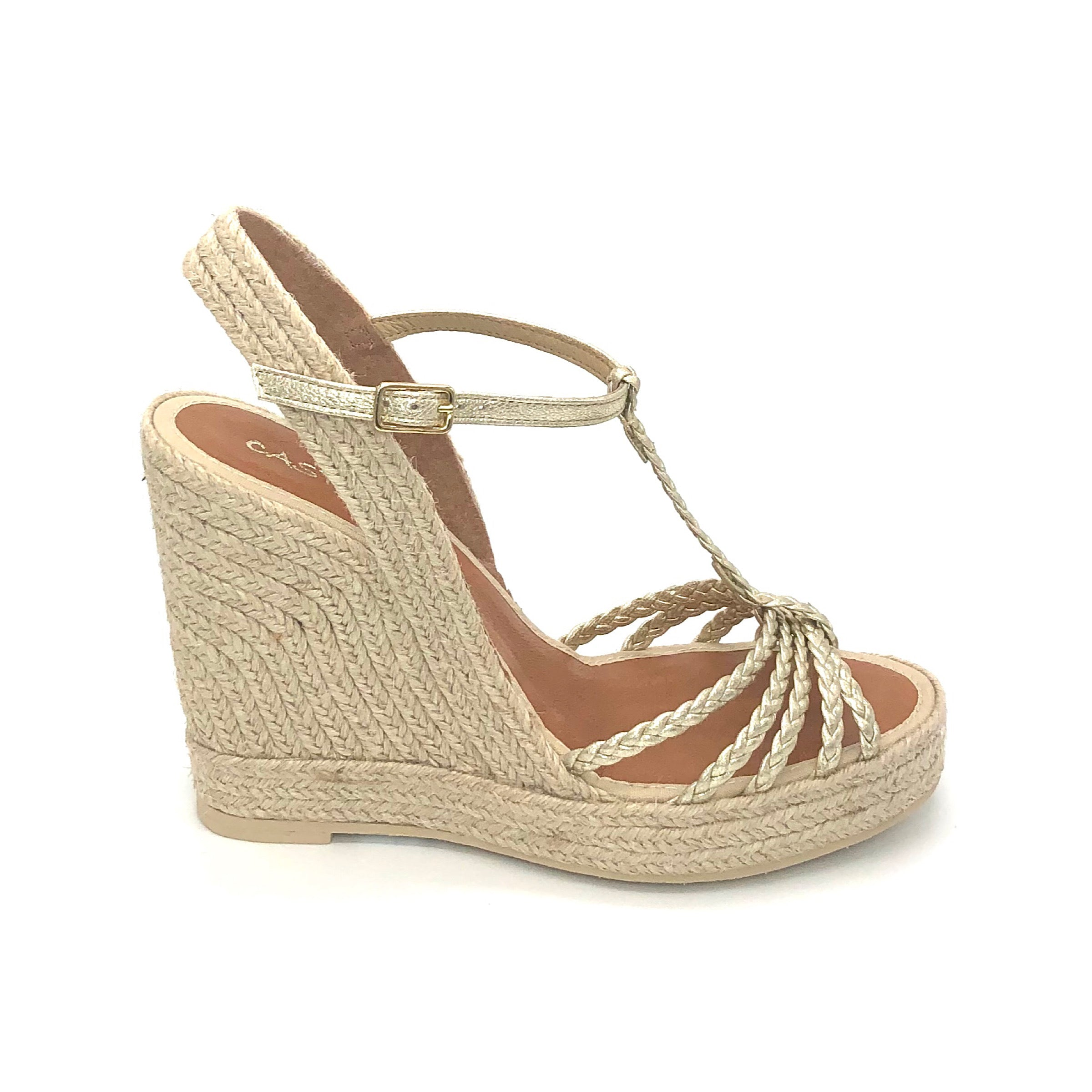 The Braided T-Strap Espadrille in Platino Metallic. This stunning multi braid t-strap sandal on high platform espadrille is a show stopper! The platino metallic thin straps instantly add hint of elegance to any outfit.