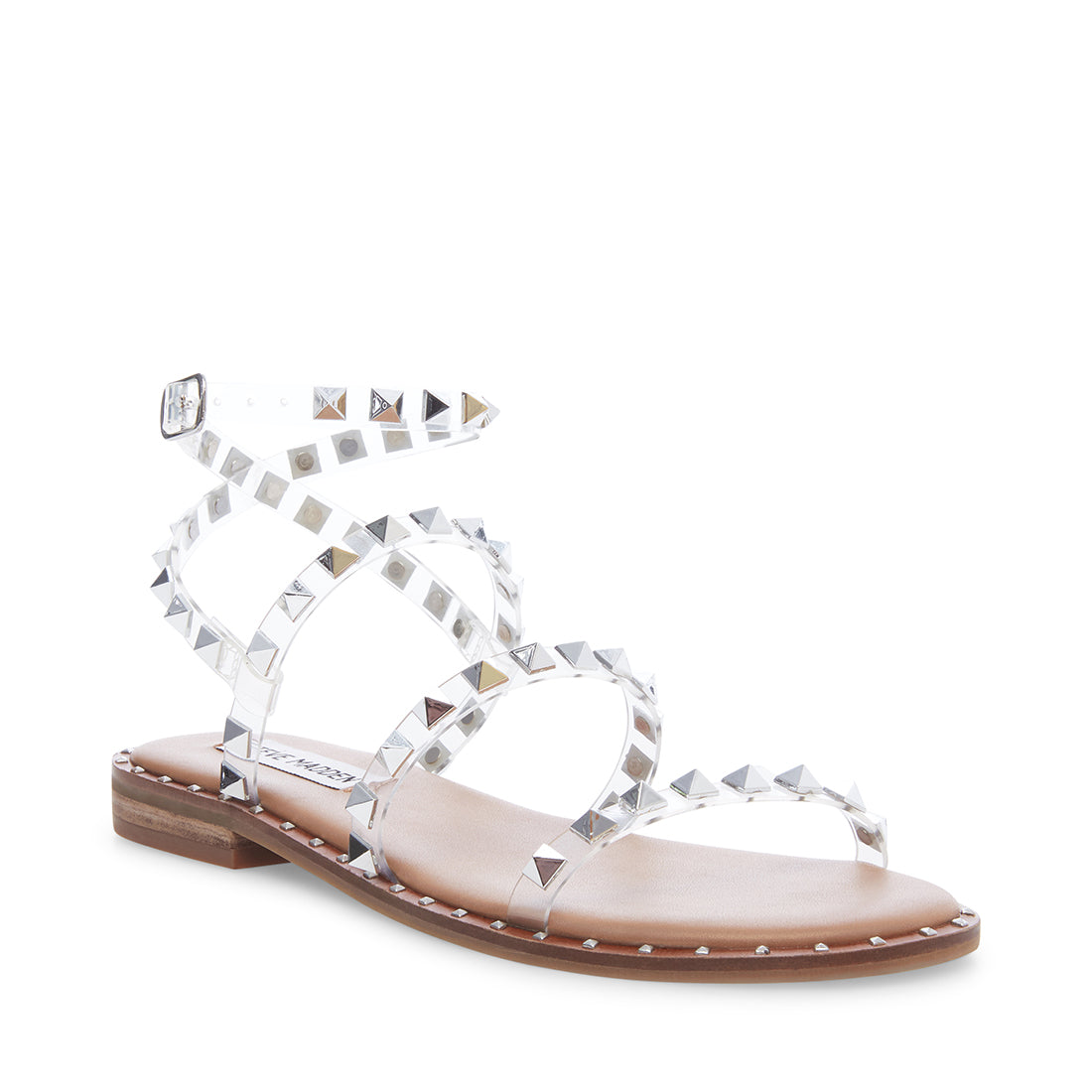 Travel - Studded Gladiator Sandal in Clear Steve Madden 194068112833  194068112802  194068112772  194068112741  194068112710  194068112680  194068112659  194068112628  194068112598  194068112567  194068112536 These edgy vinyl gladiator sandals with pyramid studs add instant attitude to any outfit.