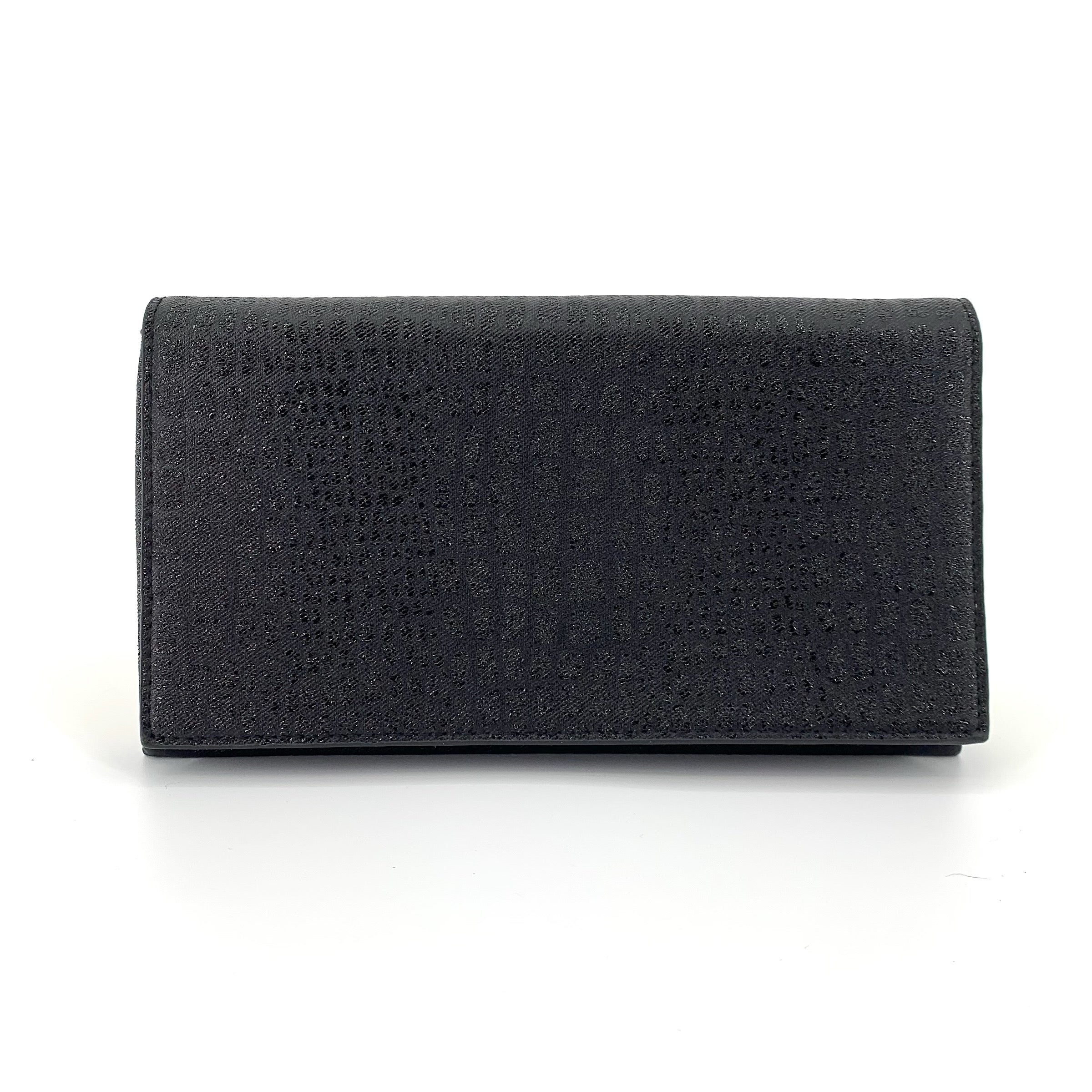 SRBE3486 - Metallic Embossed Croco Clutch in Black by Sondra Roberts. Sylishly classic update evening clutch in metallic embossed croco print. Flap over style with chain for shoulder. Interior has three compartments including zipper pocket. Imported