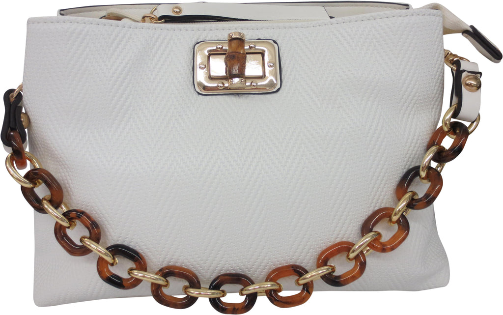 "SRB24910 - Herringbone Crossbody in White by Sondra  Roberts. Crossbody bag with herringbone embossed detail with a bamboo closure and tortoise chain detail. Top zipper closure, with three interior compartments. Vegan leather. Dimensions: 11"" W x 7""H x 4"" D. Imported."