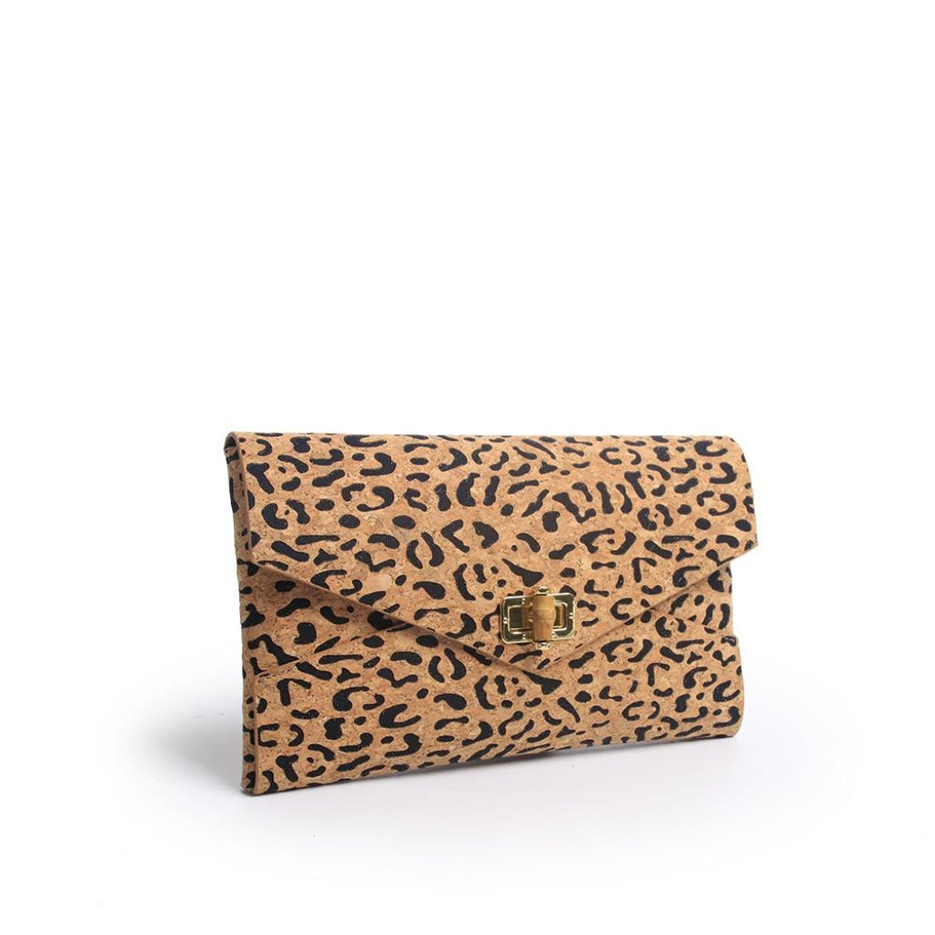"SRB25383 - Clutch in Cork with Black Accent Color by Sondra Roberts.Envelope style clutch with a turning bamboo closure in cork. Lazer cut leopard pattern with color inset. Dimensions: 11""W x 7"" H. Imported"