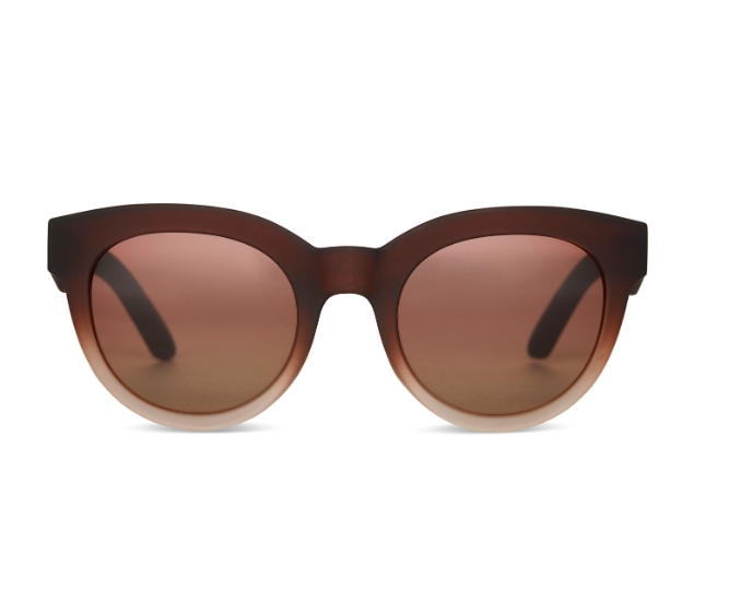 Toms Florentin - The Sunglasses in Matte Ombre with Light Brown Lenses by Toms. The Florentin is part of the Traveler Collection constructed in Solaflex for pliability and duability. Designed to bend, flex and withstand life on the move. The Florentin is a rounded frame with a slightly cat-eye shape. A flirty frame with bold proportions that make a statement. A top seller. Frame dimensions: 52-23-148. Case included.