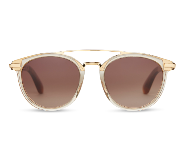Harlan - The Sunglasses in Champagne Crystal with Brown Gradient Lenses by Toms. The Harlan sunglass has an attention-grabbing metal bridge adding a unique twist to a classic style. Frame dimensions: 51-20-140. Case Included.
