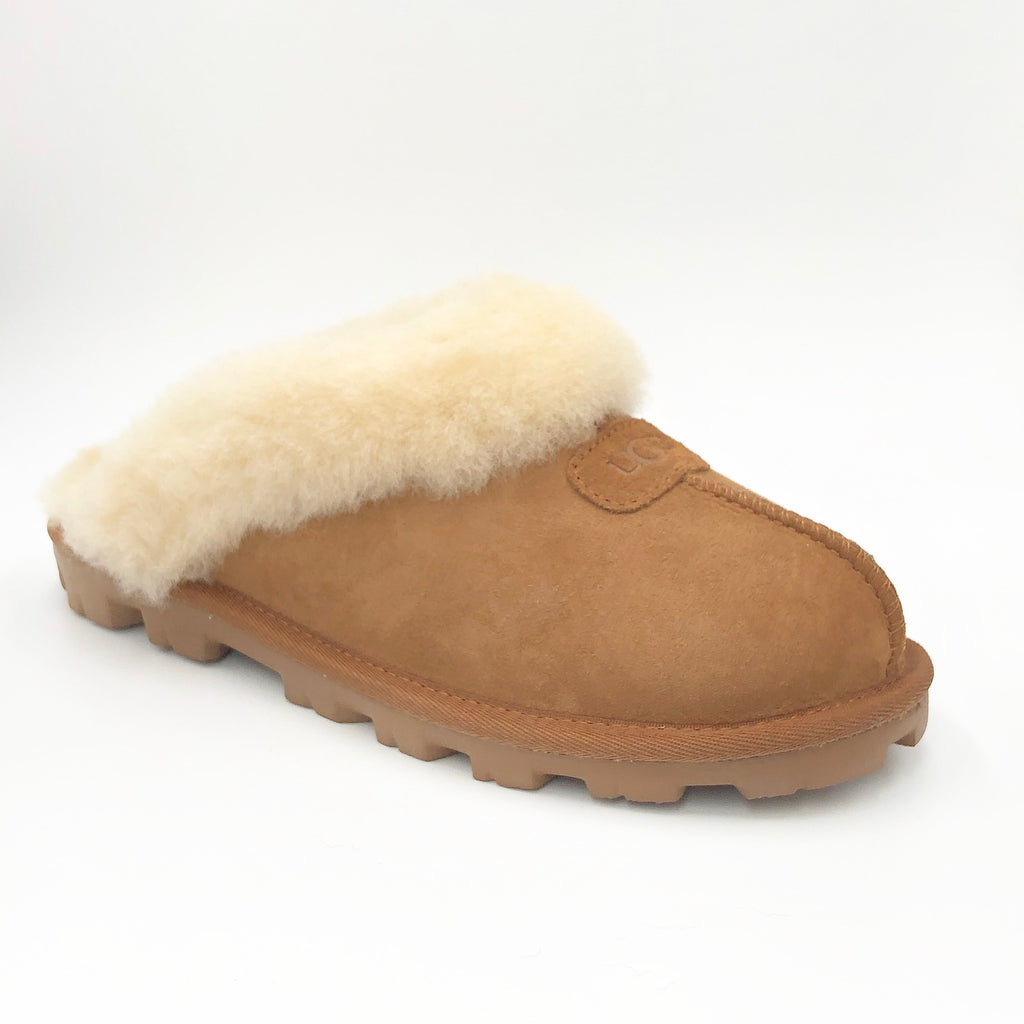 Ugg Coquette - The Classic Ugg Slipper in Chestnut. Nothing feels cozier than this Ugg classic slipper mule. Perfect for when you are working from home or walking the dog. Suede sheepskin upper & sock lining, lightweight full rubber sole.