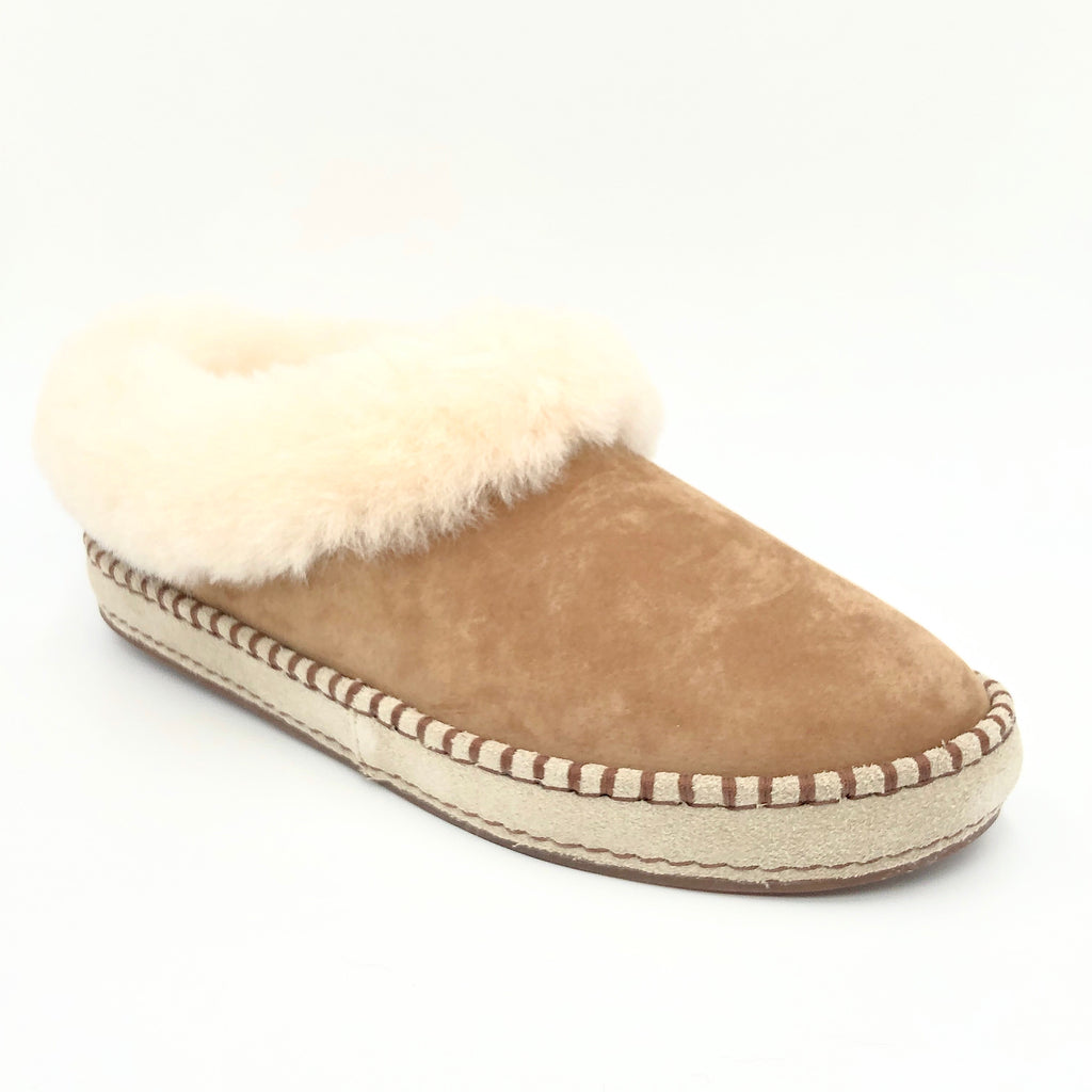 The Whip Stitch Slipper in Chestnut Wrin Ugg.  We love the mocasin feel of this cozy slipper with whipstitch detail & shearling collar . Suede sheepskin upper & sock lining, lighweight full rubber sole.