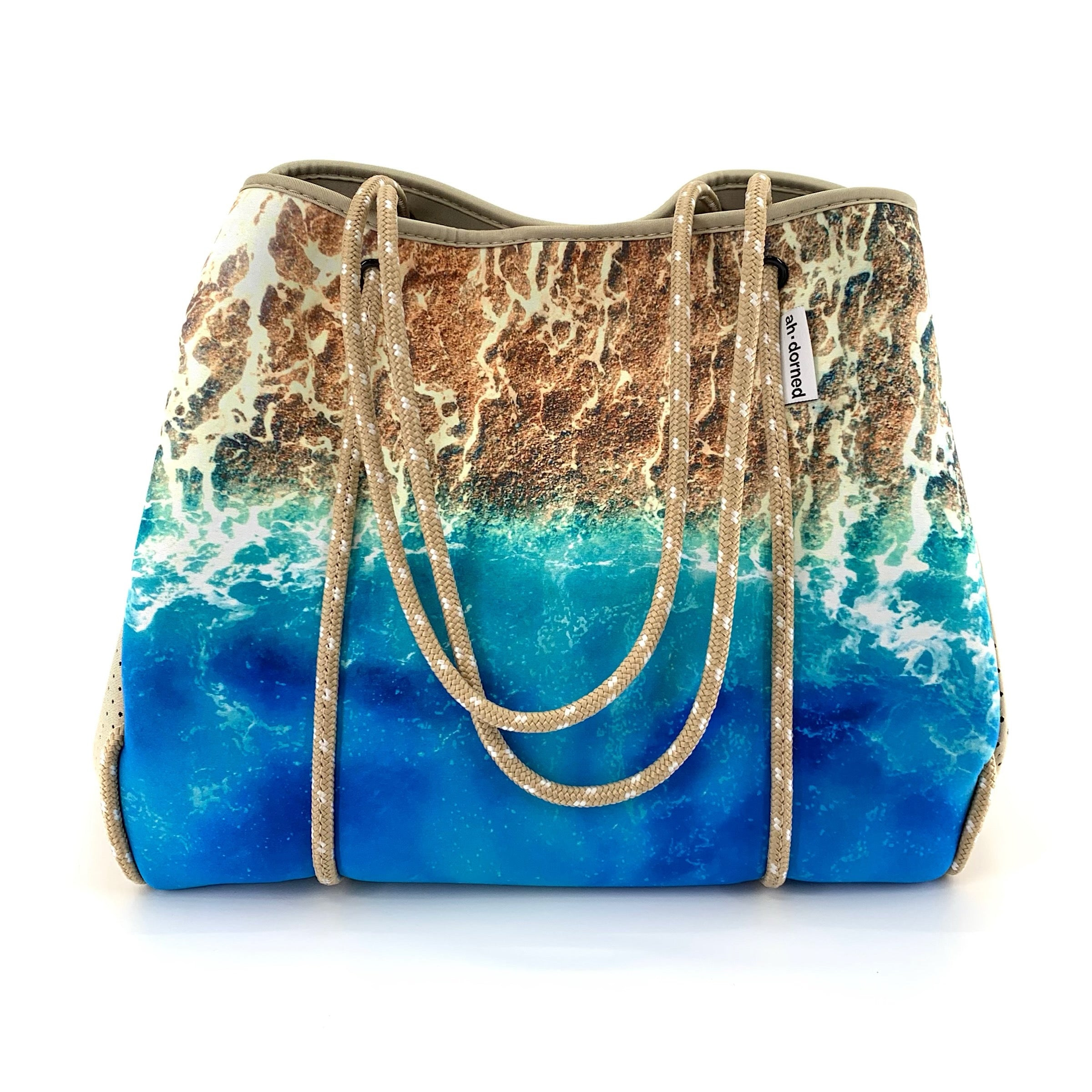 "N101BSAND  - The Ocean and Beach Aerial View Scene Neoprene Tote in Camel by Ahdorned. Ultra lightweight waterproof neoprene tote with removable bottom liner and zip front coin purse/pouch. Measures 18"" H x 12"" W x 10"" D."