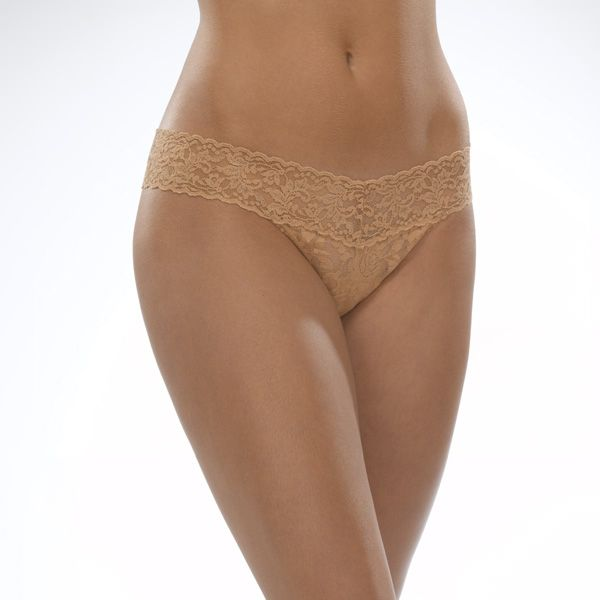 "Hanky Panky 4911P - Low Rise Thong in Suntan by Hanky Panky. Low Rise fits lower on the hips. Has a signature V-front and V-back waistband, and leaves no visible panty line. One-size fits most (Hips measuring 35""-42""). Made in the USA."