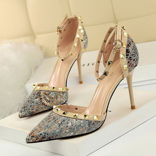 Sexy stiletto high-heeled shallow mouth pointed hollow metal rivet flat shoes