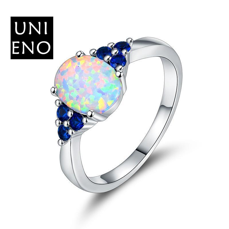 Platinum plated heart opal retro ring