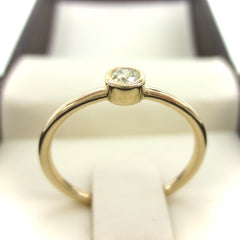 0.07 cts Bezel-Set Solitaire Yellow Diamond Ring - 14K Yellow Gold