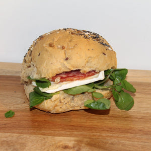 Brie and salami roll with mixed leaves