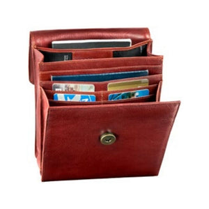 Gusseted interior has many compartments for cards with a magnet button on the whiskey leather bag by Derek Alexander.